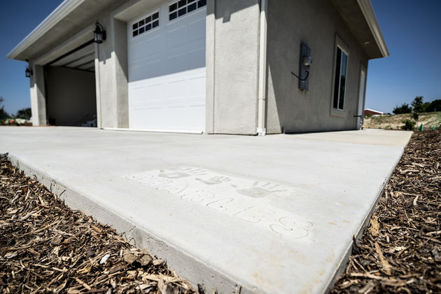 The cement outside the garage of Marine Corporal Darryl Charles' new home holds the handprints of his family.